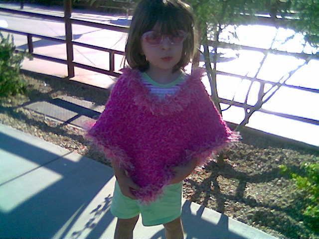 2008-08-22-allison-in-pink-poncho-knitted-by-mommy.jpg