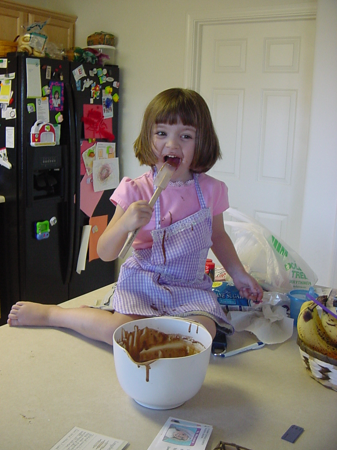 2008-10-07-allison-making-cupcakes-for-school-for-her-bday.JPG