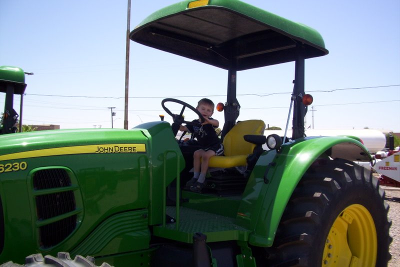 2009-07-06-a-visit-to-the-tractor-store-to-encourage-carter-to-get-pottytrained-so-he-can-get-a-tractor-toy-for-a-prize-11.JPG