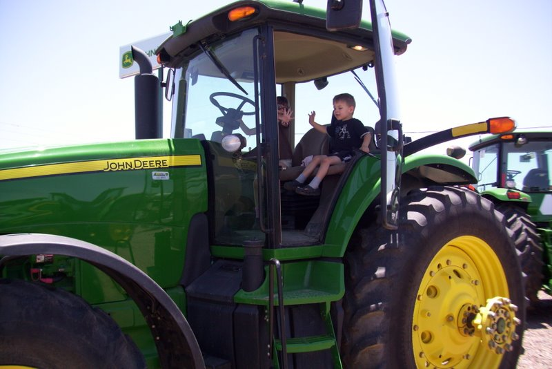 2009-07-06-a-visit-to-the-tractor-store-to-encourage-carter-to-get-pottytrained-so-he-can-get-a-tractor-toy-for-a-prize-5.JPG