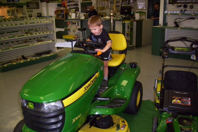 2009-07-06-a-visit-to-the-tractor-store-to-encourage-carter-to-get-pottytrained-so-he-can-get-a-tractor-toy-for-a-prize.JPG